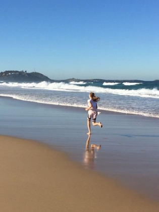 Esther running on beach